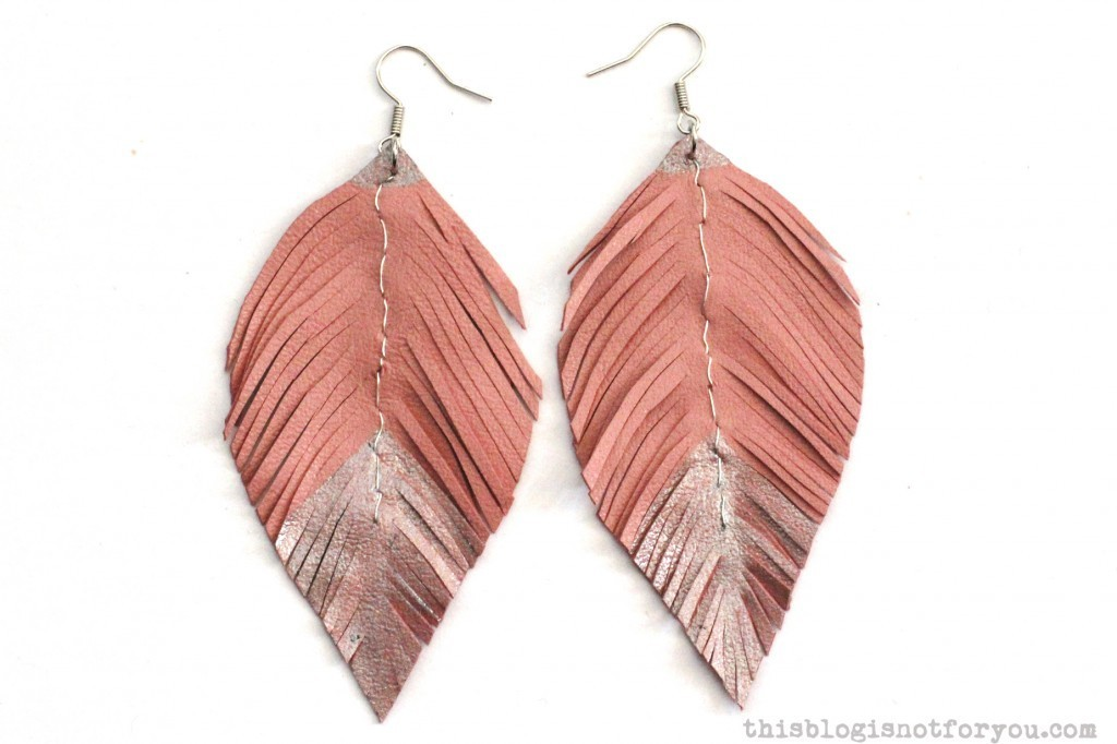 DIY leather feather earrings by thisblogisnotforyou.com